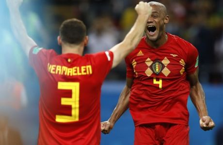 Belgium's Thomas Vermaelen, left, and Vincent Kompany celebrate after winning the quarterfinal match between Brazil and Belgium at the 2018 soccer World Cup in the Kazan Arena, in Kazan, Russia, Friday, July 6, 2018. (AP Photo/Francisco Seco)