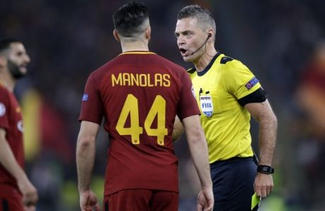 Referee Damir Skomina shows a yellow card to Roma's Kostas Manolas during the Champions League semifinal second leg soccer match between Roma and Liverpool at the Olympic Stadium in Rome, Wednesday, May 2, 2018. (AP Photo/Alessandra Tarantino)