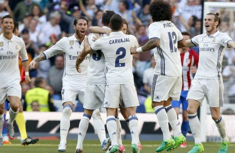 Real Madrid's Pepe, center left, celebrates with teammates after scoring a goal during a Spain's La Liga soccer match between Real Madrid and Atletico de Madrid at the Santiago Bernabeu stadium in Madrid, Spain, Saturday, April 8, 2017. (AP Photo/Daniel Ochoa de Olza)