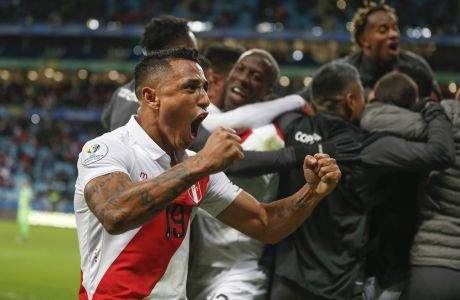 Peru's Victor Yotun celebrates his teammate's Paolo Guerrero goal against Chile during a Copa America semifinal soccer match at the Arena do Gremio in Porto Alegre, Brazil, Wednesday, July 3, 2019. Peru defeated Chile 3-0 and qualified to the final.(AP Photo/Andre Penner)