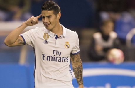 Real Madrid's James Rodriguez reacts after scoring a goal during a Spanish La Liga soccer match between Deportivo La Coruna and Real Madrid at the Riazor stadium in A Coruna, Spain, Wednesday April 26, 2017. (AP Photo/Lalo R. Villar)