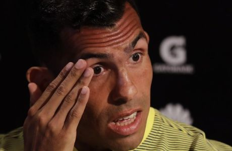 Carlos Tevez attends a press conference during his presentation as a new member of the Boca Juniors soccer team in Cardales, Argentina, Tuesday, Jan. 9, 2018. Tevez joins Boca Juniors for a third time in his career. (AP Photo/Natacha Pisarenko)