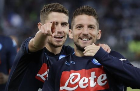 Napoli's Jorginho, left, celebrates with his teammate Dries Mertens after scoring during a Serie A soccer match between Lazio and Napoli, at the Rome Olympic stadium, Wednesday, Sept. 20, 2017. (AP Photo/Alessandra Tarantino)