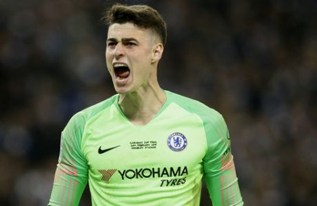 Chelsea goalkeeper Kepa Arrizabalaga reacts after stops a shot from Manchester City's Leroy Sane during a penalty shootout at the end of the English League Cup final soccer match between Chelsea and Manchester City at Wembley stadium in London, England, Sunday, Feb. 24, 2019. (AP Photo/Tim Ireland)