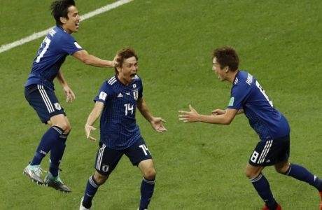 Japan's Takashi Inui, center, celebrates with teammates after scoring his second side goal during the round of 16 match between Belgium and Japan at the 2018 soccer World Cup in the Rostov Arena, in Rostov-on-Don, Russia, Monday, July 2, 2018. (AP Photo/Hassan Ammar)