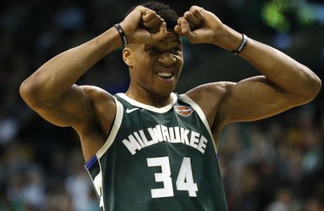 Milwaukee Bucks' Giannis Antetokounmpo reacts to a foul called against his team during the first quarter of an NBA basketball game against the Boston Celtics in Boston, Monday, Dec. 4, 2017. (AP Photo/Winslow Townson)