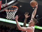 Portland Trail Blazers forward Meyers Leonard, right, dunks over Golden State Warriors forward Draymond Green during the second half of Game 4 of the NBA basketball playoffs Western Conference finals Monday, May 20, 2019, in Portland, Ore. The Warriors won 119-117 in overtime. (AP Photo/Craig Mitchelldyer)