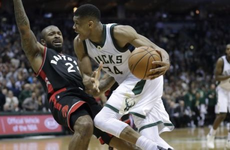 Milwaukee Bucks' Giannis Antetokounmpo runs into Toronto Raptors' DeMarre Carroll during the second half of Game 6 of an NBA first-round playoff series basketball game Thursday, April 27, 2017, in Milwaukee. The Raptors won 92-89 to win the series. (AP Photo/Morry Gash)