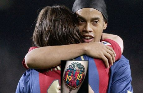 Barcelona player Lionel Messi, from Argentina, left, is congratulated by his teammate Ronaldinho after he scored his last minute goal during their Spanish league soccer match against Real Madrid at Camp Nou Stadium in Barcelona, Spain, Saturday, March. 10, 2007. (AP Photo/Manu Fernandez)