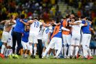 FORTALEZA, BRAZIL - JUNE 24:  Greece players celebrate the 2-1 win after the 2014 FIFA World Cup Brazil Group C match between Greece and Cote D'Ivoire at Estadio Castelao on June 24, 2014 in Fortaleza, Brazil.  (Photo by Lars Baron - FIFA/FIFA via Getty Images)