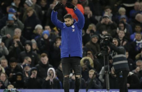 Chelsea's Olivier Giroud waves to the fans at half time after he was introduced, during the English Premier League soccer match between Chelsea and Bournemouth at Stamford Bridge in London, Wednesday Jan. 31, 2018. (AP Photo/Tim Ireland)