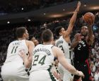 Toronto Raptors' Kawhi Leonard shoots in traffic during the second half of Game 1 of the NBA Eastern Conference basketball playoff finals against the Milwaukee Bucks Wednesday, May 15, 2019, in Milwaukee. The Bucks won 108-100 to take a 1-0 lead in the series. (AP Photo/Morry Gash)