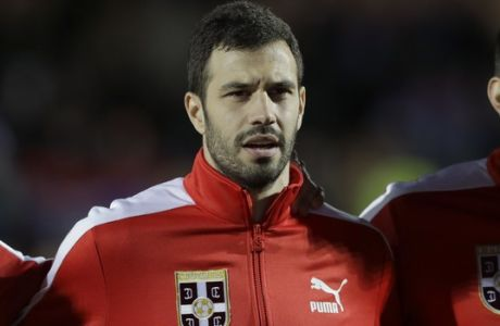 Serbia's Luka Milivojevic lines up during his country's national anthem before the international friendly soccer match between Serbia and Nigeria at The Hive Stadium in London, Tuesday, March 27, 2018. (AP Photo/Matt Dunham)
