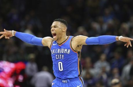 Oklahoma City Thunder guard Russell Westbrook reacts after hitting a 3-point shot at the buzzer against the Sacramento Kings in an NBA basketball game in Sacramento, Calif., Thursday, Feb. 22, 2018. The Thunder won 110-107. (AP Photo/Steve Yeater)