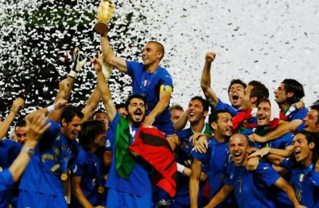 BERLIN - JULY 09:  The Italian players celebrate as Fabio Cannavaro of Italy lifts the World Cup trophy aloft following victory in a penalty shootout at the end of the FIFA World Cup Germany 2006 Final match between Italy and France at the Olympic Stadium on July 9, 2006 in Berlin, Germany.  (Photo by Shaun Botterill/Getty Images)