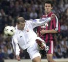 ** FILE ** Real Madrid's Zinedine Zidane scores the winning goal watched by Bayer Leverkusen's Michael Ballack during the UEFA Champions League final soccer match at Hampden Park in Glasgow, Scotland in this Wednesday, May 15, 2002 file photo. Zidane said on Wednesday April 26, 2006 that his retirement from professional soccer after the World Cup in Germany was a considered decision, which would allow Real Madrid to make plans for next season. (AP Photo)