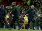 Manchester United's manager Jose Mourinho, right, and Liverpool's head coach Juergen Klopp walk away from each other after shaking hands at the end of the English Premier League soccer match between Manchester United and Liverpool at Old Trafford stadium in Manchester, England, Sunday, Jan. 15, 2017. (AP Photo/Dave Thompson)