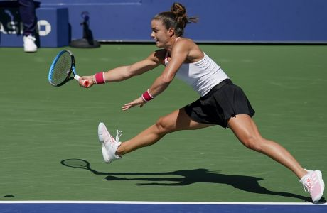 Maria Sakkari, of Greece, returns a shot to Serena Williams, of the United States, during the quarterfinals of the US Open tennis championships, Monday, Sept. 7, 2020, in New York. (AP Photo/Seth Wenig)