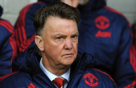 Manchester United manager Louis van Gaal watches from the dug out during the English Premier League soccer match between West Bromwich Albion and Manchester United, at the Hawthorns in West Bromwich, England, Sunday, March 6, 2016. (AP Photo/Rui Vieira)