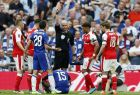 Referee Anthony Taylor, center, sends off Chelsea's Victor Moses, on the ground, after showing him a second yellow card during the English FA Cup final soccer match between Arsenal and Chelsea at Wembley stadium in London, Saturday, May 27, 2017. (AP Photo/Kirsty Wigglesworth)