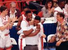 UNLV players Moses Scurry, left, and Anderson Hunt hug their coach Jerry Tarkanian after their 103-73 victory over Duke in the NCAA Final Four Championship game, April 2, 1990, in Denver, Colorado.  (AP Photo/Susan Ragan)