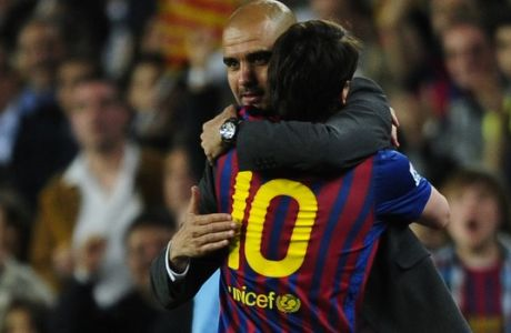 FC Barcelon's coach Pep Guardiola, left, embraces Lionel Messi, from Argentina, after scores during a Spanish La Liga soccer match at the Camp Nou stadium in Barcelona, Spain, Saturday, May 5, 2012. FC Barcelona's coach Pep Guardiola will not continue as coach of the Spanish club after this season and assistant Tito Vilanova will take over. (AP Photo/Manu Fernandez)