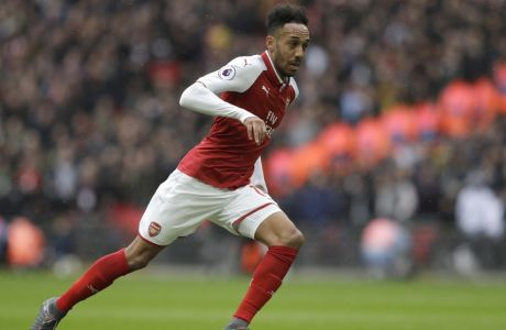 Arsenal's Pierre-Emerick Aubameyang takes with the ball forward towards the goal but he is rules off side during the English Premier League soccer match between Tottenham Hotspur and Arsenal at Wembley stadium in London, Saturday, Feb. 10, 2018. (AP Photo/Matt Dunham)