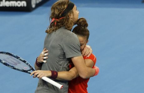 Stefanos Tsitsipas and Maria Sakkari of Greece celebrate winning their mixed doubles match against Switzerland's Roger Federer and Belinda Bencic at the Hopman Cup in Perth, Australia, Thursday Jan. 3, 2019. (AP Photo/Trevor Collens)