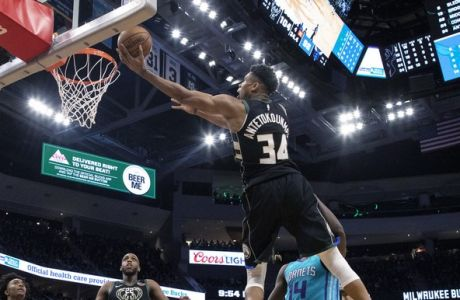 Milwaukee Bucks' Giannis Antetokounmpo (34) shoots against the Charlotte Hornets during the second half of an NBA basketball game Friday, Jan. 25, 2019, in Milwaukee. (AP Photo/Jeffrey Phelps)