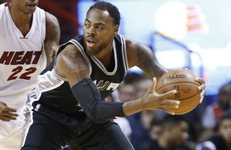 San Antonio Spurs forward Deshaun Thomas looks for an opening past Miami Heat forward Greg Whittington (22) during the second half of a preseason NBA basketball game, Monday, Oct. 12, 2015, in Miami. The Heat defeated the Spurs 97-94. (AP Photo/Wilfredo Lee)