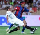 FC Barcelona's Ronaldinho, from Brazil, right, duels for the ball with Sevilla's Javier Navarro, from Spain, during the UEFA Super Cup soccer match at the Stadium Louis II in Monaco, Friday Aug. 25, 2006. (AP Photo/Manu Fernandez)