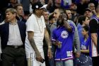 Kevin Hart, right, reacts with NBA Hall of Famer Allen Iverson, left, during the second half in Game 2 of a first-round NBA basketball playoff series between the Miami Heat and the Philadelphia 76ers, Monday, April 16, 2018, in Philadelphia. The Heat won 113-103. (AP Photo/Chris Szagola)
