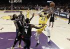 Los Angeles Lakers' LeBron James (23) shoots over Los Angeles Clippers' JaMychal Green (4) and Montrezl Harrell (5) during the second half of an NBA basketball game Monday, March 4, 2019, in Los Angeles. (AP Photo/Marcio Jose Sanchez)