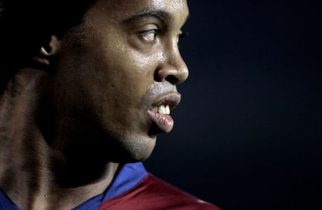 FC Barcelona player Ronaldinho, from Brazil, looks on against Levante during a Spanish league soccer match at the Camp Nou Stadium in Barcelona, Spain, Sunday, Feb. 24, 2008. (AP Photo/Manu Fernandez)