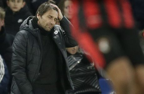 Chelsea manager Antonio Conte looks dejected during the English Premier League soccer match between Chelsea and Bournemouth at Stamford Bridge in London, Wednesday Jan. 31, 2018. (AP Photo/Tim Ireland)