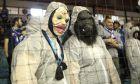 Φίλαθλοι του Ηρακλή με μάσκες και στολή για τον... κορονοϊό σε στιγμιότυπο της αναμέτρησης με τον Ιωνικό για την ΕΚΟ Basket League 2019-2020 στο 'Ιβανώφειο', Κυριακή 1 Μαρτίου 2020