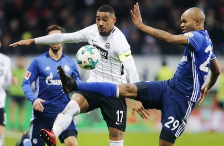 Frankfurt's Kevin-Prince Boateng, left, and Schalke's Naldo challenge for the ball during a German first division Bundesliga soccer match between Eintracht Frankfurt and FC Schalke 04 in Frankfurt, Germany, Saturday, Dec. 16, 2017. (AP Photo/Michael Probst)