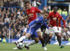 Manchester Uniteds Ander Herrera, left, and Chelseas Eden Hazard challenge for the ball during the English Premier League soccer match between Chelsea and Manchester United at Stamford Bridge stadium in London, Sunday, Oct. 23, 2016.(AP Photo/Kirsty Wigglesworth)