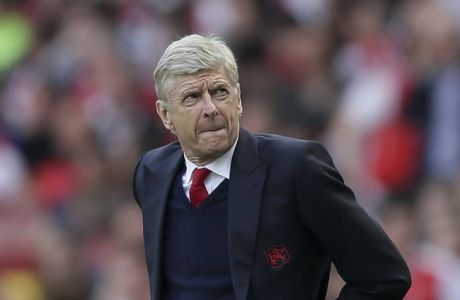 Arsenal manager Arsene Wenger looks across the pitch during the English Premier League soccer match between Arsenal and Everton at The Emirates stadium in London, Sunday, May 21, 2017. (AP Photo/Tim Ireland)