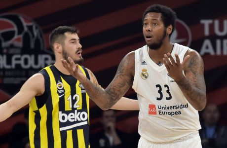 Madrid's Trey Thompkins, right, and Fenerbahce's Nikola Kalinic react during their Final Four Euroleague third place basketball match between Real Madrid and Fenerbahce Beko Istanbul at the Fernando Buesa Arena in Vitoria, Spain, Sunday, May 19, 2019. (AP Photo/Alvaro Barrientos)