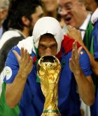 BERLIN - JULY 09:  Francesco Totti of Italy kisses the world cup trophy following his team's victory during the FIFA World Cup Germany 2006 Final match between Italy and France at the Olympic Stadium on July 9, 2006 in Berlin, Germany.  (Photo by Michael Steele/Getty Images)