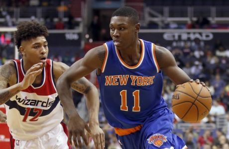 New York Knicks forward Cleanthony Early (11) drives as he is guarded by Washington Wizards forward Kelly Oubre Jr. (12) in the first half of an NBA preseason basketball game, Friday, Oct. 9, 2015, in Washington. (AP Photo/Alex Brandon)