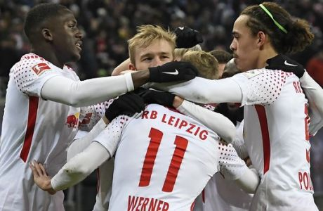 Leipzig's Timo Werner, center, celebrates together with his teammates after scoring a goal during the German first division Bundesliga soccer match between RB Leipzig and Bayern Munich in Leipzig, Germany, Sunday, March 18, 2018. (AP Photo/Jens Meyer)