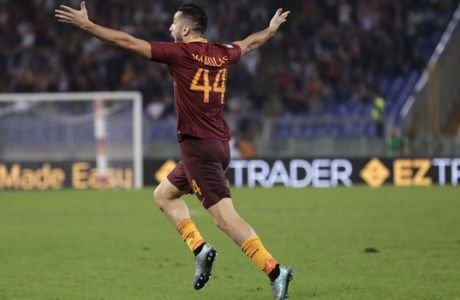 Romas Kostas Manolas celebrates after scoring during a Serie A soccer match between Roma and Inter Milan, at Rome's Olympic Stadium, Sunday, Oct. 2, 2016. (AP Photo/Andrew Medichini)