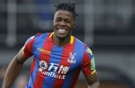 Crystal Palace's Wilfried Zaha reacts after missing a chance to score during their English Premier League soccer match between Crystal Palace and Liverpool at Selhurst Park stadium in London, Saturday, March, 31, 2018. (AP Photo/Alastair Grant)