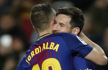 FC Barcelona's Lionel Messi celebrates after scoring with his teammate Jordi Alba during the Spanish Copa del Rey round of 16 second leg soccer match between FC Barcelona and Celta de Vigo at the Camp Nou stadium in Barcelona, Spain, Thursday, Jan. 11, 2018. (AP Photo/Manu Fernandez)