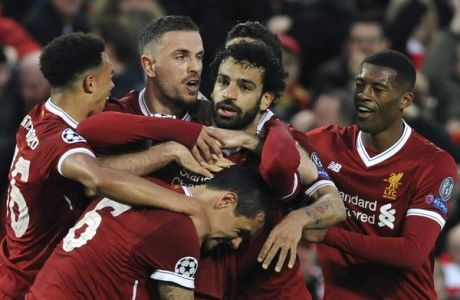 Liverpool's Mohamed Salah, center, celebrates with teammates after scoring his side's opening goal during the Champions League semifinal, first leg, soccer match between Liverpool and Roma at Anfield Stadium, Liverpool, England, Tuesday, April 24, 2018. (AP Photo/Rui Vieira)