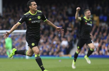 Chelsea's Pedro celebrates scoring his side's first goal of the game during their English Premier League soccer match against Everton at Goodison Park, Liverpool, England, Sunday, April 30, 2017. (Nigel French/PA via AP)