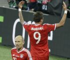 Bayern's Arjen Robben of the Netherlands, left, and Bayern's Mario Mandzukic of Croatia celebrate after Mandzukic scored the opening goal during the Champions League Final soccer match between  Borussia Dortmund and Bayern Munich at Wembley Stadium in London, Saturday May 25, 2013. (AP Photo/Alastair Grant)