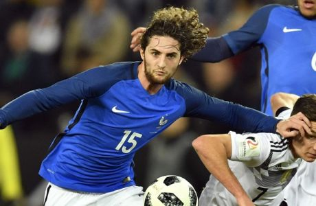 France's Adrien Rabiot, left, and Germany's Julian Draxler, right, challenge for the ball during an international friendly soccer match between Germany and France in Cologne, Germany, Tuesday, Nov. 14, 2017. (AP Photo/Martin Meissner)